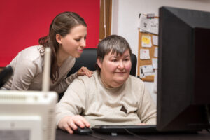 Caregiver,And,Mentally,Disabled,Woman,Learning,At,The,Computer,,Special